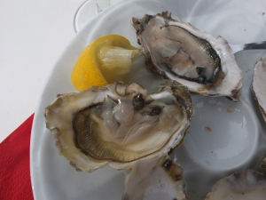 We read that the locals eat oysters and drink white wine after they shop their flowers. It's true.