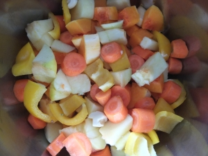 Squash, carrots, apples, bell peppers all chopped up and ready to boil.