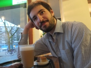 Here is N., happily enjoying his latte.