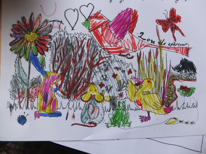 I LOVE this one, drawn by a little girl. Look at all the colors of the rabbit!