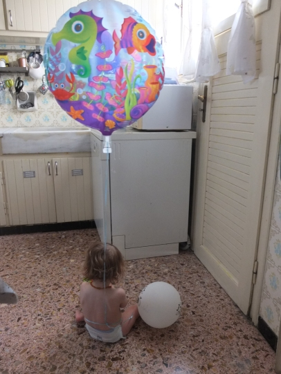 Some times toddlers are tricky to spot with all their hiding tricks and running away habits. Tying a balloon around their waist solves this.