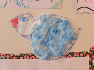 To make this bird I drew the outline with crayons and then helped Loulou stick cotton balls on the bird. She then painted it using finger paint dissolved in water. It's the saddest bird I have ever seen but we still like it around here.