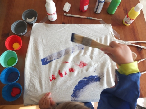 Offering a variety of tools to paint with is a great idea to encourage toddlers to explore.