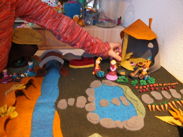 Loulou Maya playing with the finished playscape